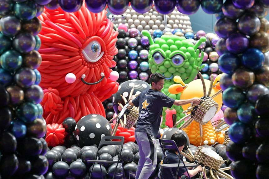 An alien invasion has descended upon Marina Square shopping mall, with balloon sculptures shaped like a huge 4.8m-tall rocket, extraterrestrials, astronauts, UFOs, and more, taking over the Central Atrium in the mall. The annual balloon event, now in