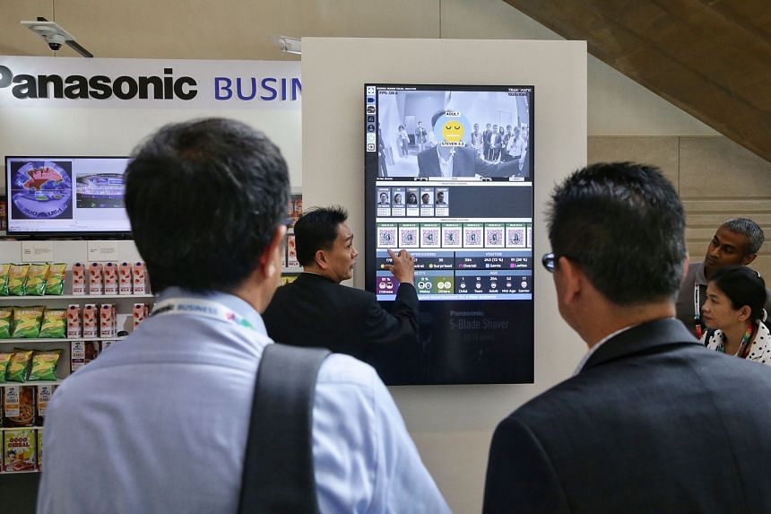 Right: Panasonic Security Solutions business division head Alvin Quek demonstrating the FacePRO facial recognition software. Below: A Panasonic staff member showing how the latest smart cameras and built-in analytics can be used by retailers.