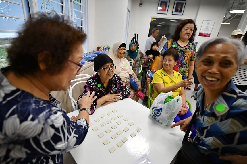 Seniors playing the Finding 114 memory game at THK Seniors Activity Centre @ Fengshan 114.
