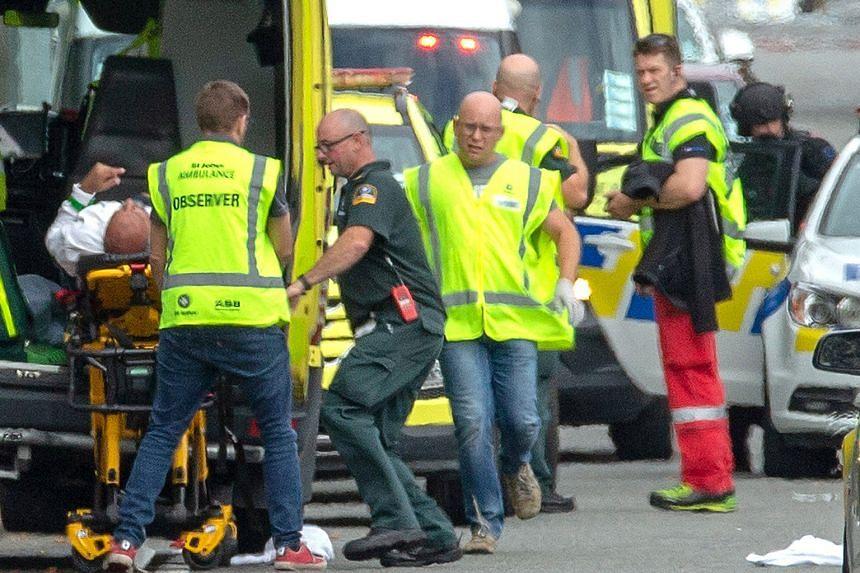 An injured victim being taken to an ambulance.