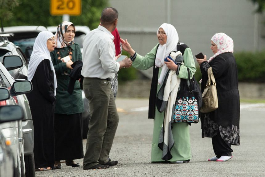 Worried family members waiting outside the mosque after the shooting that resulted in multiple fatalities and injuries at the Al Noor Mosque in Deans Avenue in Christchurch.