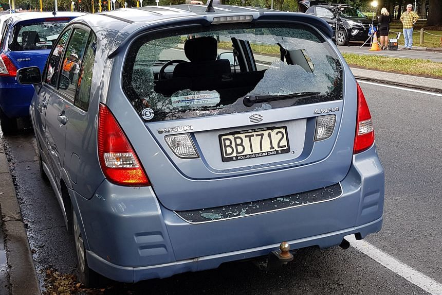 The shattered window of a car parked close to the Al Noor Mosque, where a gunman opened fire on worshippers.