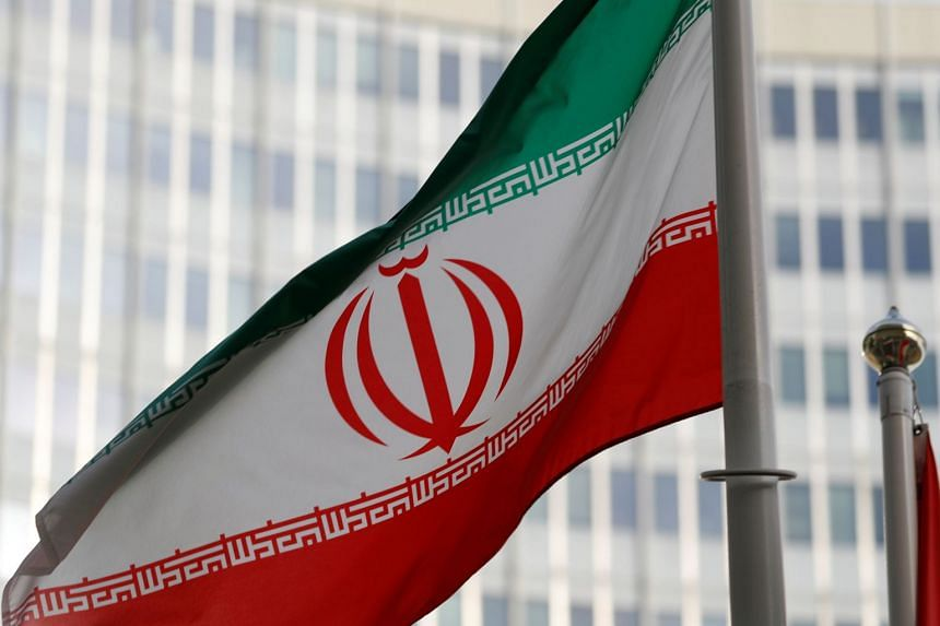 An Iranian flag in front the International Atomic Energy Agency headquarters in Vienna, Austria.