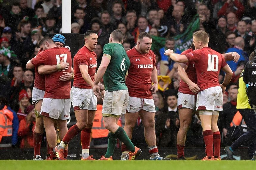 Wales players celebrate after the match.
