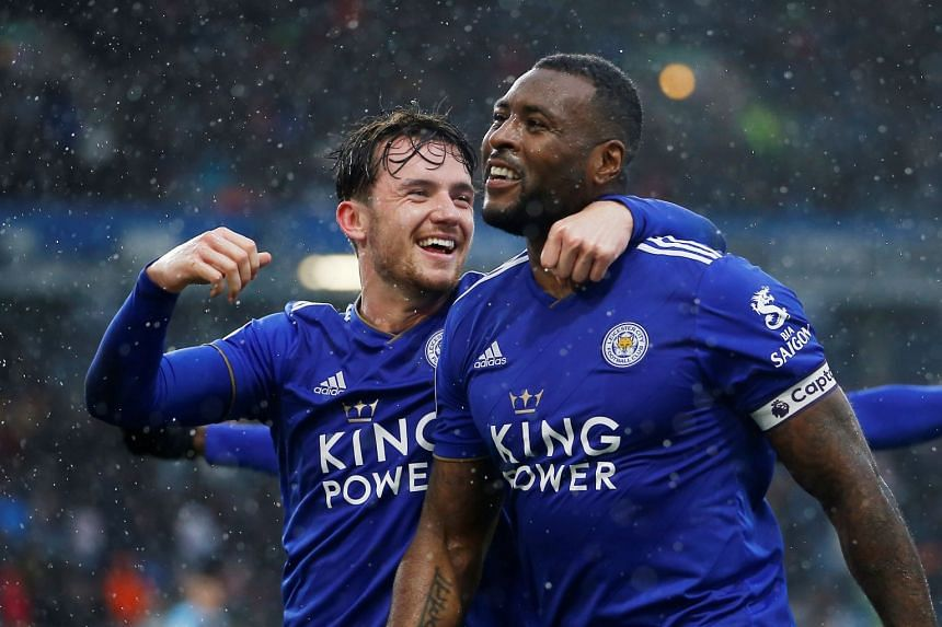 Leicester City's Wes Morgan celebrates scoring their second goal with Ben Chilwell.