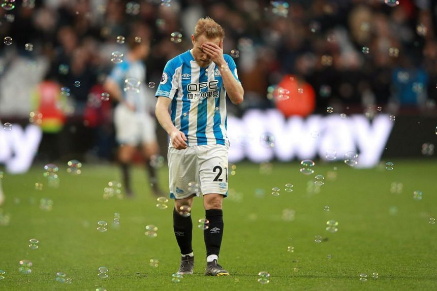 Huddersfield Town's Alex Pritchard reacts after West Ham's third goal.