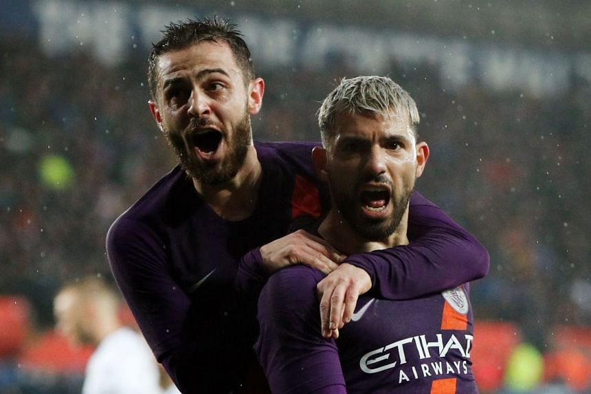 Manchester City's Sergio Aguero celebrates with Bernardo Silva after scoring their third goal.