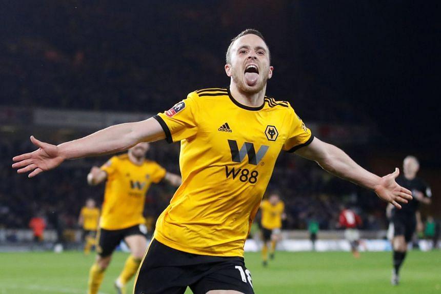 Wolverhampton Wanderers' Diogo Jota celebrates scoring their second goal.