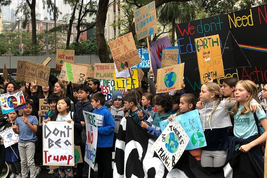 """Schoolchildren in Hong Kong were among the million students across the globe who skipped school to demonstrate last Friday, calling for stronger action on climate change. """"If we let climate change go on, we won't have a future,"""" says Luna Uribe (left"""