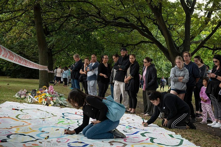 Societies need to come down hard on Islamophobic people, says Minister for Law and Home Affairs K. Shanmugam. Mourners gathering near Al Noor Mosque in Christchurch, New Zealand, yesterday as the country grappled with grief and horror a day after 49