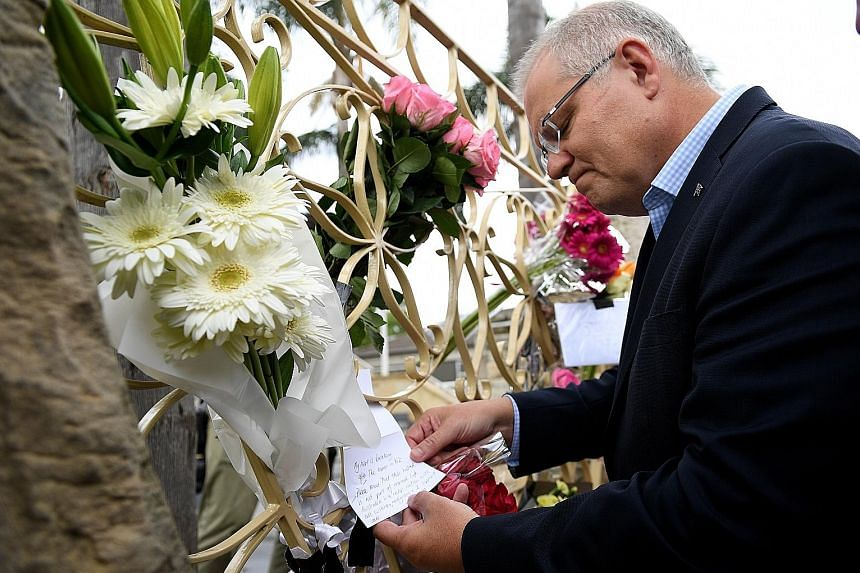 A young man threw an egg at Queensland Senator Fraser Anning at a press conference in Moorabbin, Melbourne yesterday. Australian Prime Minister Scott Morrison looking at tributes to the Christchurch attack victims during a visit to the Lakemba Mosque