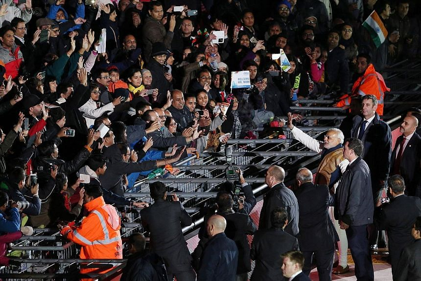 India's Prime Minister Narendra Modi waving to the crowd at Wembley Stadium in London on Nov 13, 2015, after addressing a welcome rally during his visit to Britain. India's ruling BJP has made outreach to overseas Indians a major initiative and Mr Mo