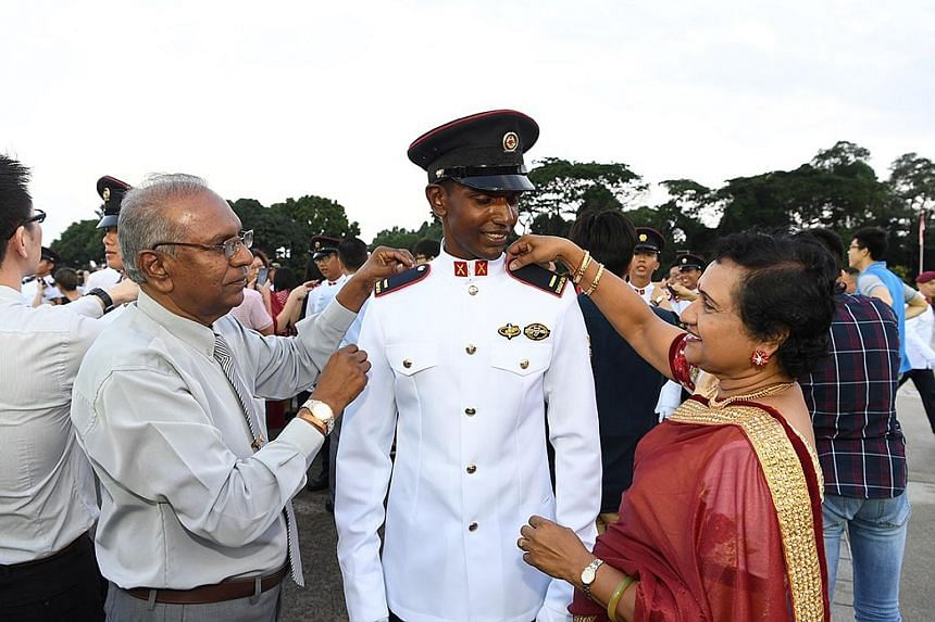 Second-Lieutenant Hamaran Muthayya with his proud parents at the officer commissioning parade at Safti Military Institute yesterday.