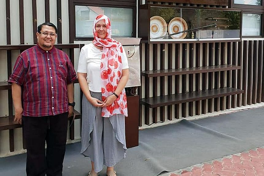 Al-Huda Mosque chairman Azman Kassim with New Zealander Kim Forrester, who paid a visit to the mosque in Bukit Timah yesterday to apologise and pray for the safety and prosperity of all Muslims.