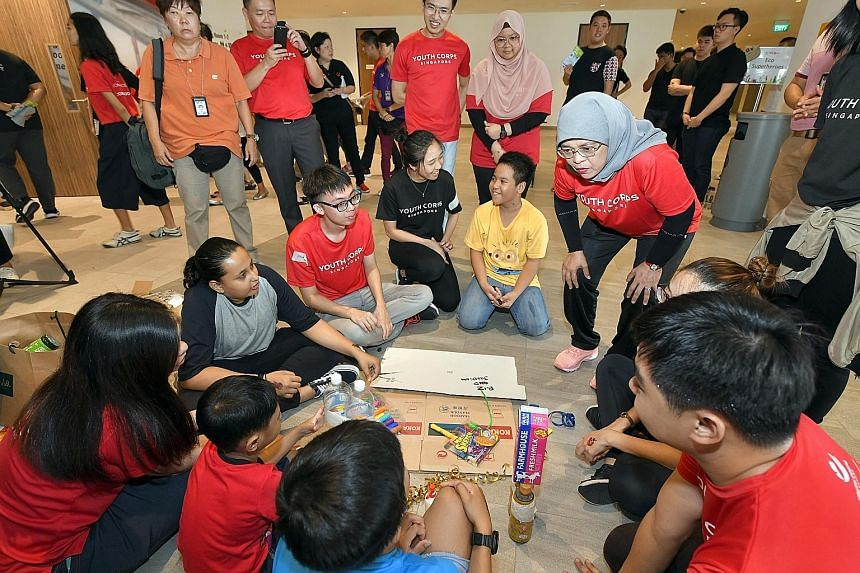 President Halimah Yacob taking part in activities with youth volunteers and beneficiaries at the launch of Youth Corps Service Week 2019.