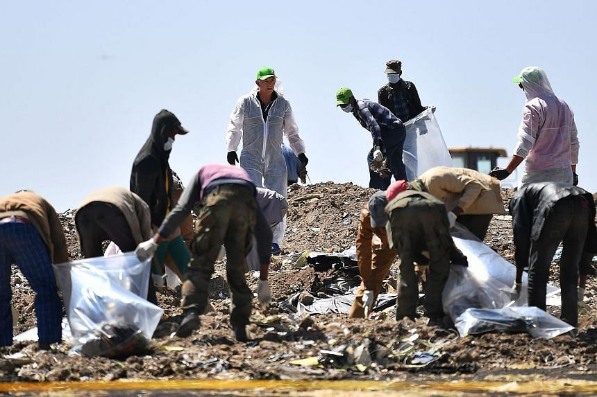 People searching for belongings and debris for forensic analysis at the crash site of the Ethiopian Airlines-operated Boeing 737 Max plane outside the town of Bishoftu last Friday. Boeing last week outlined changes it expected to make as a result of