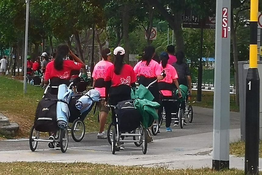 A photo showing a group of students pulling hiking trailers behind them while on an Outward Bound Singapore expedition sparked debate.