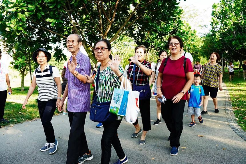 Participants on a 30-minute stroll during Walk 2 Remember at Bishan-Ang Mo Kio Park yesterday. More than 300 people took part in the walkathon, including seniors and their caregivers.