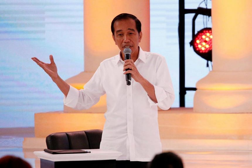Indonesia's presidential candidate Joko Widodo speaks during a debate with his opponent Prabowo Subianto (not pictured) in Jakarta, on Feb 17, 2019.