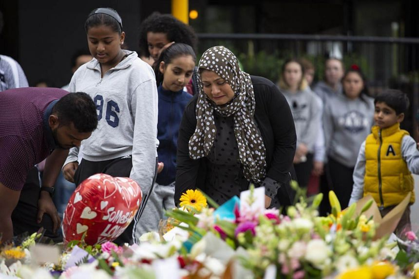 Mourners at a makeshift memorial along Deans Avenue near Al Noor mosque in Christchurch, New Zealand, March 16, 2019.