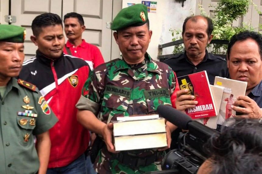 Indonesian officials raiding a book store and seizing what they say were communism-related books in Padang, West Sumatra, on Jan 8, 2019.