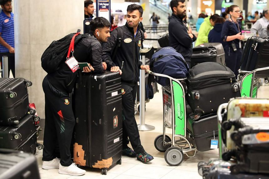 Team members wait to check-in at Christchurch International Airport in New Zealand.