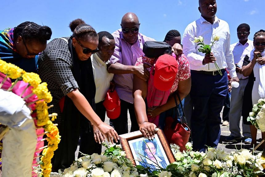 Families of victims from Kenya and Rwanda lay flowers on March 15, 2019, as they visit the crash site.
