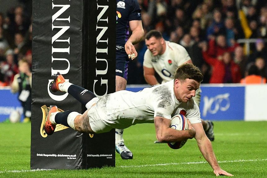 England's George Ford dives over the line to score England's final try.
