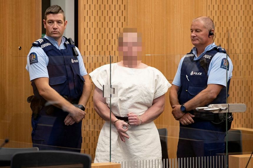 GESTURE OF HATRED:  New Zealand terror attack:Brenton Tarrant, the right-wing extremist who filmed himself while on a shooting rampage that left 49 mosque-goers dead, flashed a white power gesture as he appeared in a New Zealand court yesterday charg