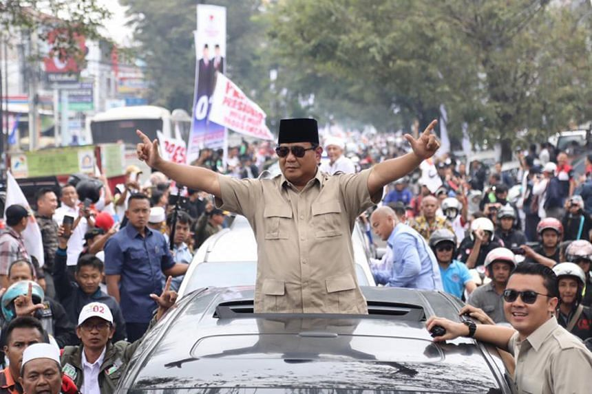 Presidential candidate Prabowo Subianto on a visit to Cianjur, in West Java. His campaign has so far zeroed in on bread-and-butter issues, a potential weak spot for Mr Joko. President Joko Widodo has not lost an election since he entered politics 15