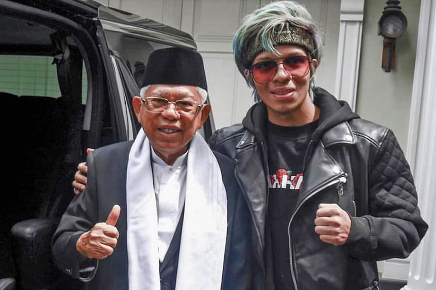 """Dr Ma'ruf with Muhammad Attamimi """"Atta"""" Halilintar, the first YouTuber in South-east Asia with over 10 million subscribers. The photo of them standing shoulder to shoulder shows a commonality or connection between Dr Ma'ruf and millennial voters like"""