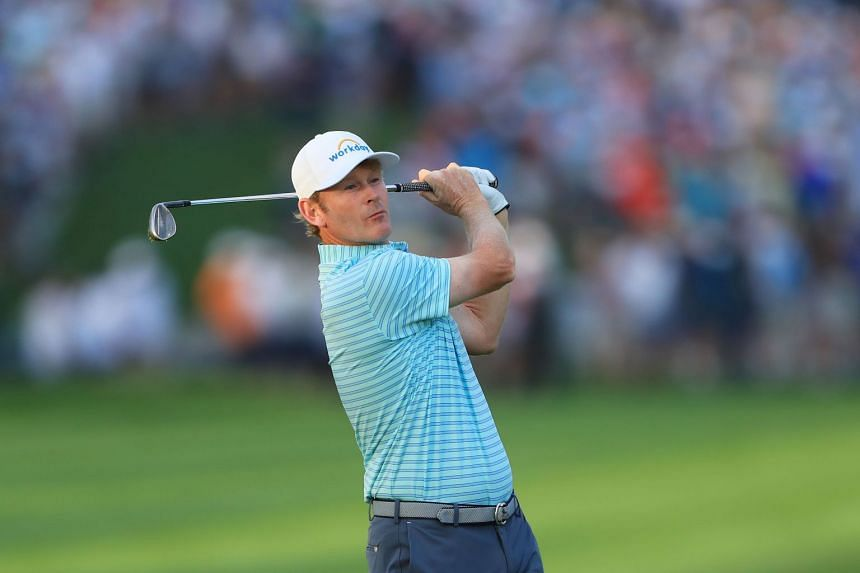 Brandt Snedeker of the United States plays his second shot on the 10th hole.