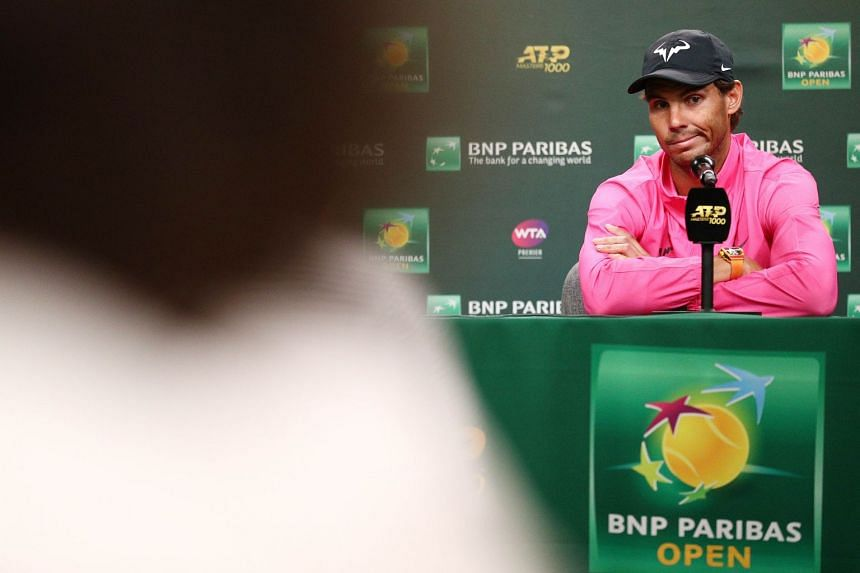 Nadal speaks to the media after withdrawing from his semi-final against Roger Federer.
