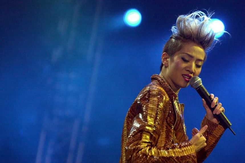 The mother of cantopop singer Anita Mui (pictured, performing in 2002) was given HK$250,000 (S$43,000) by a trust to celebrate her 95th birthday.