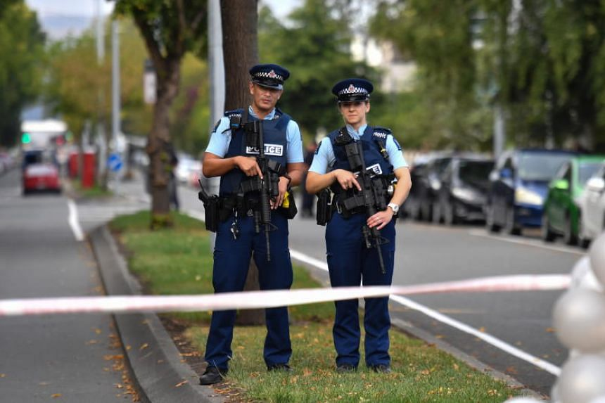 Armed police officers patrol near the Al Noor Mosque in Christchurch, New Zealand, on March 17, 2019.