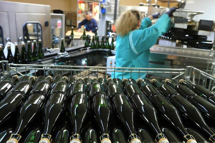 Bottles of champagne are seen being prepared at the Pol Roger factory in Epernay, eastern France.