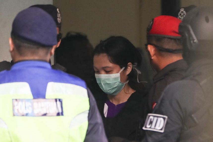 Vietnamese suspect Doan Thi Huong, who is currently detained in connection with the death of Kim Jong Nam, being escorted by Malaysian police officers in Kuala Lumpur on March 15, 2019.