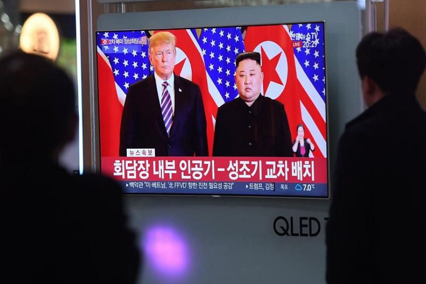 A television screen showing a news report about the meeting between Donald Trump and Kim Jong Un in Hanoi, at a station in Seoul on Feb 27, 2019.