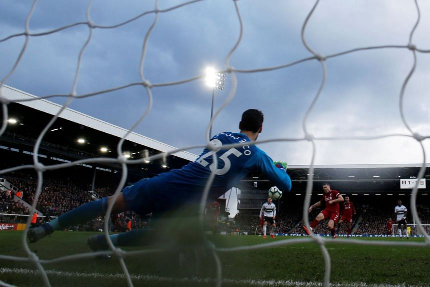 Liverpool's James Milner scoring their second, and winning, goal against Fulham from the penalty spot at Craven Cottage in London on March 17, 2019.