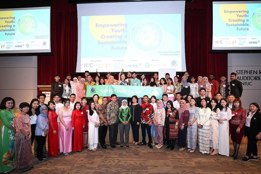 President Halimah Yacob (centre) with the Asean delegates at the Global Compact Network Singapore Youth Forum 2019 yesterday. About 300 local and foreign youth engaged Madam Halimah in a dialogue.