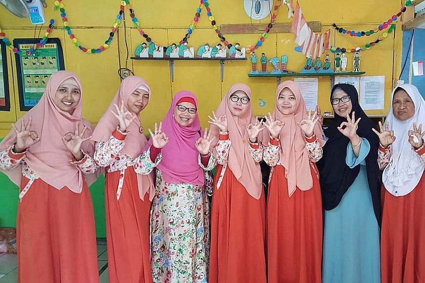 Ms Dwi Septiawati Djafar (third from left) of the Prosperous Justice Party with her constituents. She is running for office in Bekasi, Karawang and Purwakarta regencies in West Java to push for the empowerment of women, children and families. The upc