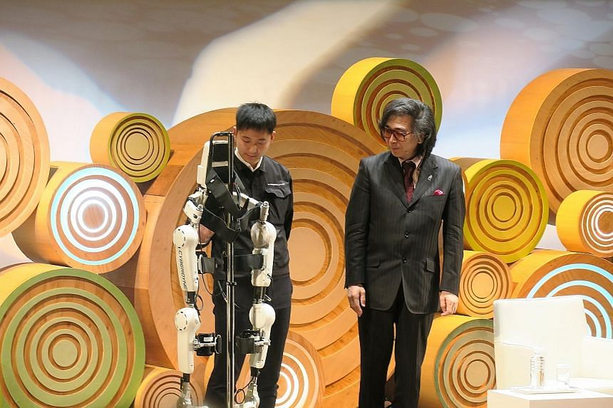 Dr Yoshiyuki Sankai (right), a pioneer in cybernics, at a demonstration of the Hybrid Assistive Limb, which has been billed as the world's first cyborg-type robot to assist and enhance human motion.
