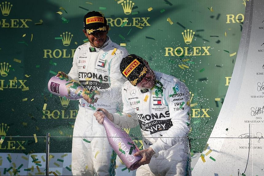 Lewis Hamilton, second in Melbourne for the fourth straight year, spraying champagne on winner and Mercedes teammate Valtteri Bottas. The Briton's frustrating run at the Albert Park circuit continued as he has been able to convert only two of his rec