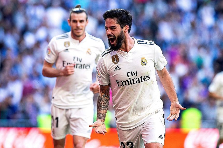 Isco celebrating after scoring the first of Real Madrid's two goals against Celta Vigo at the Santiago Bernabeu stadium on Saturday.