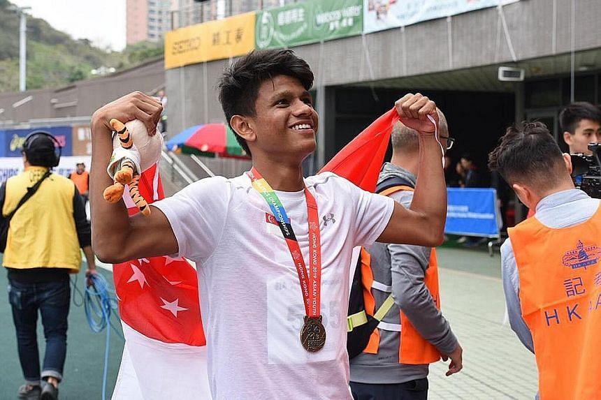 Marc Brian Louis celebrating his 400m hurdles win at the Asian Youth Athletics Championships in Hong Kong yesterday.
