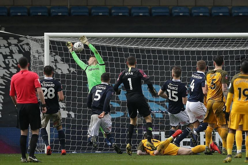 Millwall goalkeeper David Martin fluffing a free kick from Brighton's Solly March in the fifth minute of stoppage time, which earned the English south coast side a 2-2 draw in their FA Cup quarter-final and forced extra time at the Den in London yest
