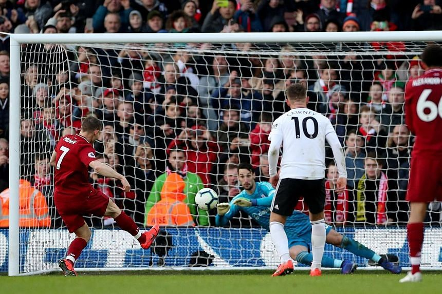 Liverpool midfielder James Milner calmly sending Fulham goalkeeper Sergio Rico the wrong way to restore the Reds' lead. They won 2-1 to return to the top of the Premier League, two points ahead of Manchester City, who have played one game fewer.