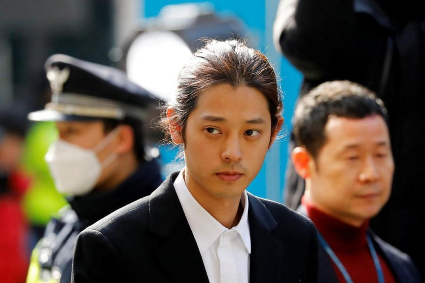 Singer Jung Joon-young arrives for questioning on accusations of illicitly taping and sharing sex videos on social media, at the Seoul Metropolitan Police Agency in Seoul, South Korea, on March 14, 2019.