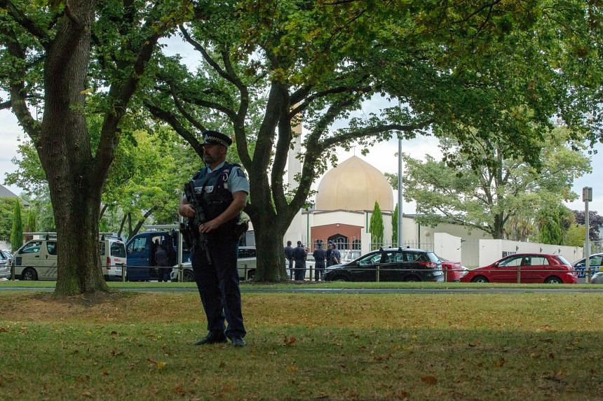 A policeman stands guard in front of Christchurch's Al Noor mosque.