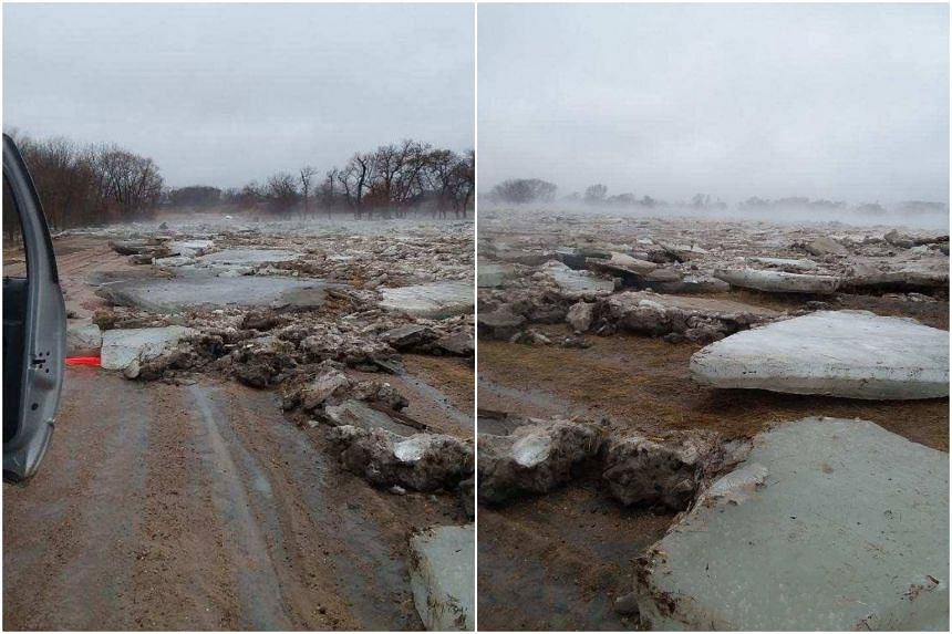 Ice blocks brought by flood waters lie on the road in Howard County, Nebraska, on March 13, 2019.